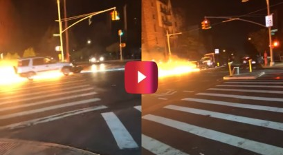 Car Pushes Flaming Motorcycle down Street