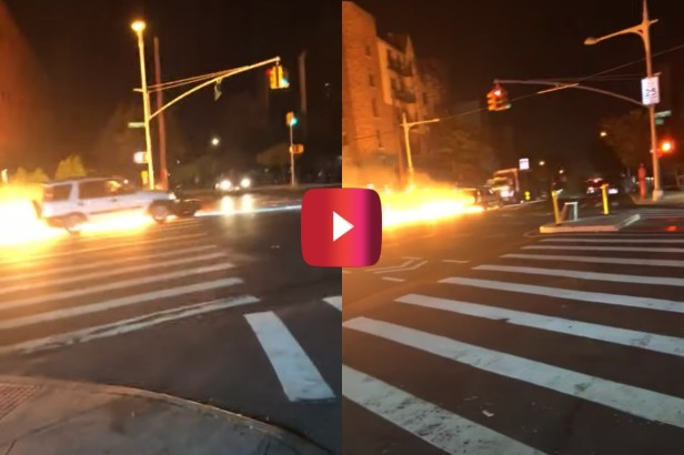 Car Pushes Flaming Motorcycle Down NYC Street