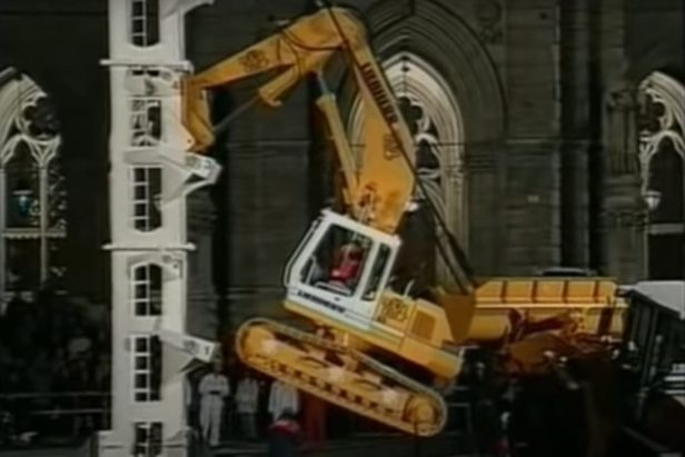 Excavator Scales Steel Tower in Wild TV Segment
