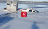 Truck Towing Ice Shanty Sinks Into Lake Michigan