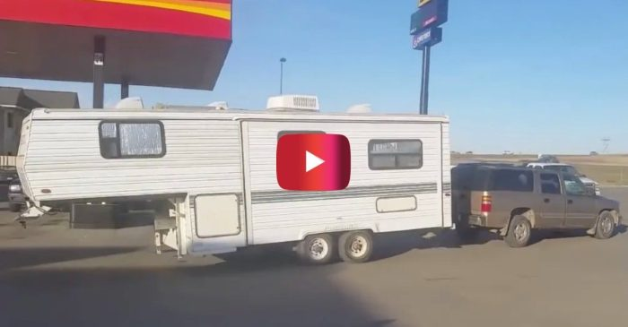 Driver Pulls 5th Wheel Camper Backwards With Bumper Hitch