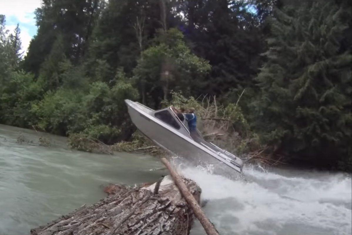 jet boat jumps over log