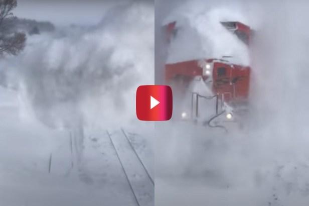 Train Travels Through Snow Drift During Massive Blizzard