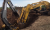trapped excavator rescue