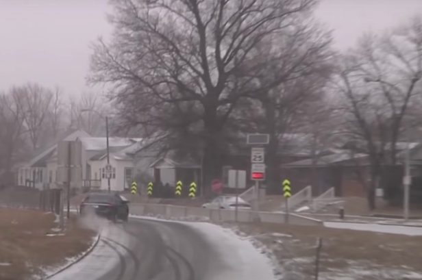 Car Slides Off Icy Road, Nearly Careens Into Row of Houses