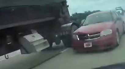 car spins out after failing to yield to semi