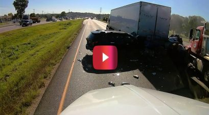 dump truck plows into cars