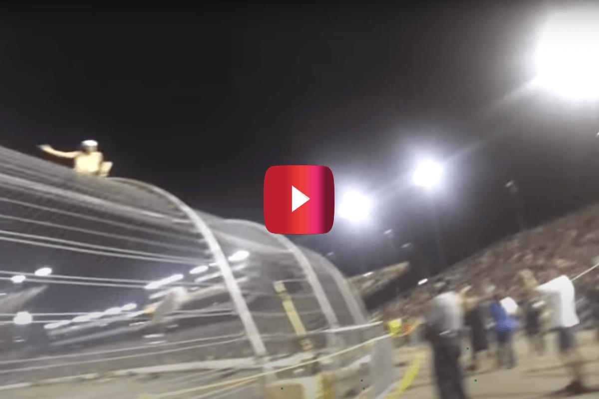 nascar fan climbs fence