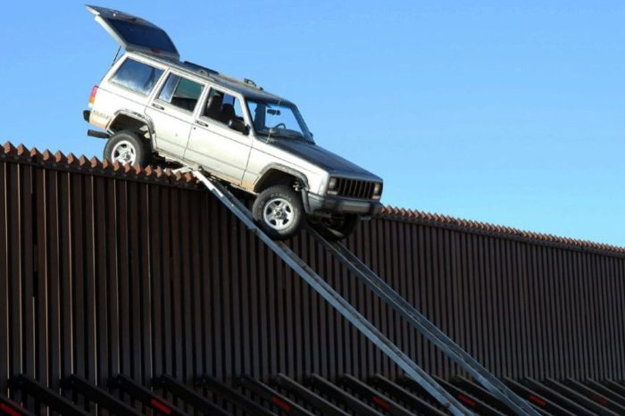 Drug Smugglers Get SUV Stuck on Top of Border Fence
