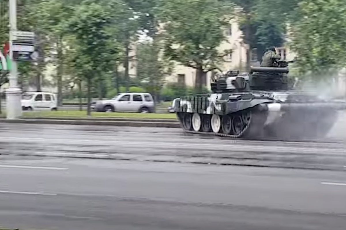 tank slams into light pole