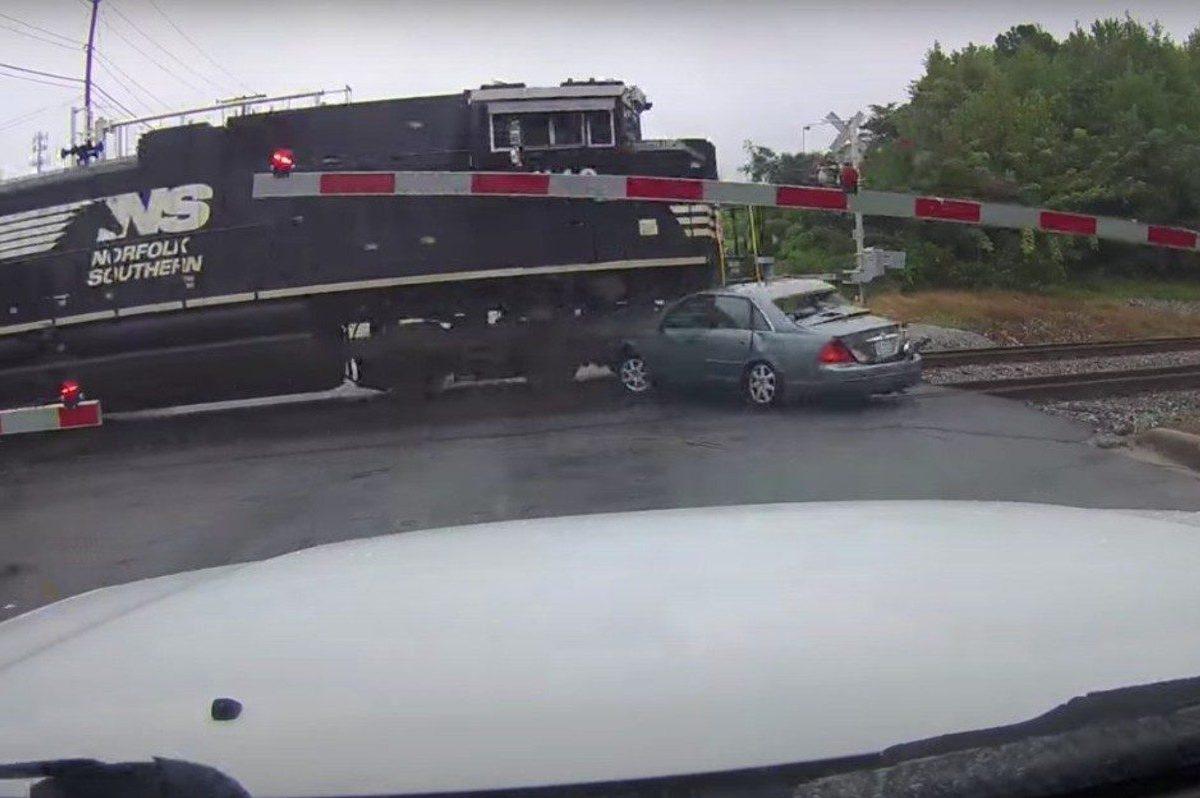 train plows through car