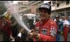 F1 driver Aryton Senna celebrates with fans.