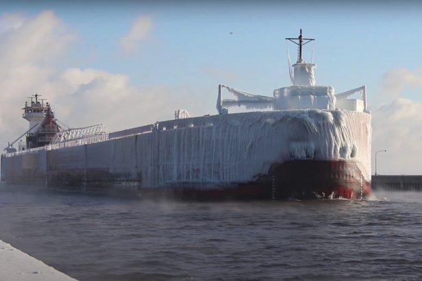 "Massive Ice-Coated ""Ghost Ship"" Pulling Into Canal Is an Incredible Sight"