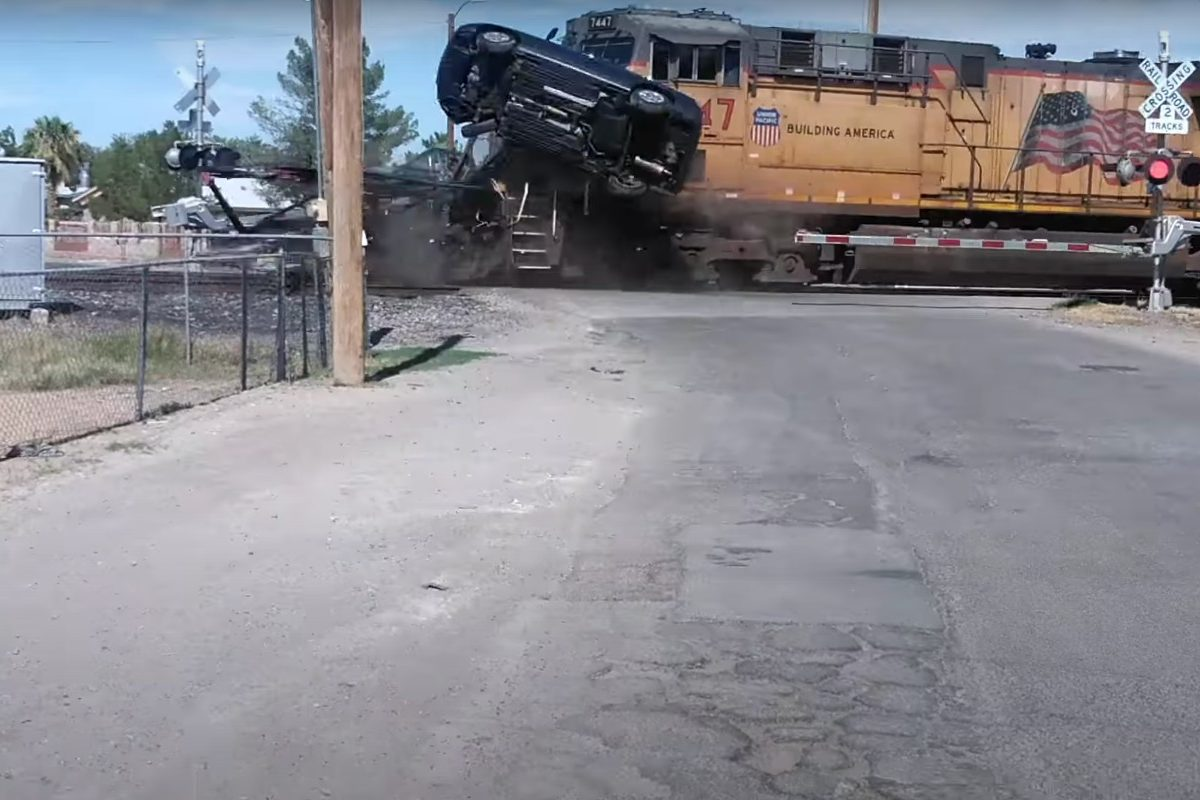 Train Takes out Car Carrier