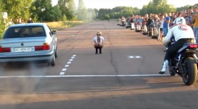 motorcycle vs. bmw drag race fail