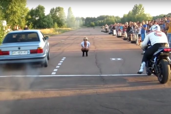Biker Tries Facing BMW in Drag Race, but Bites It Big Time