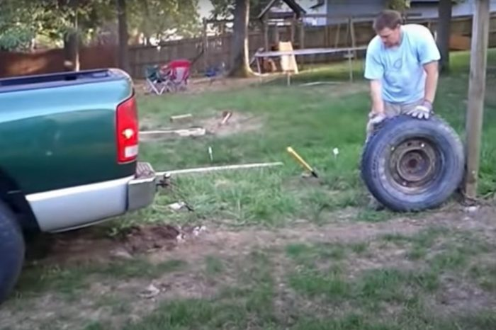 Man Removes Fence Post Using a Truck, a Tire, and a Chain