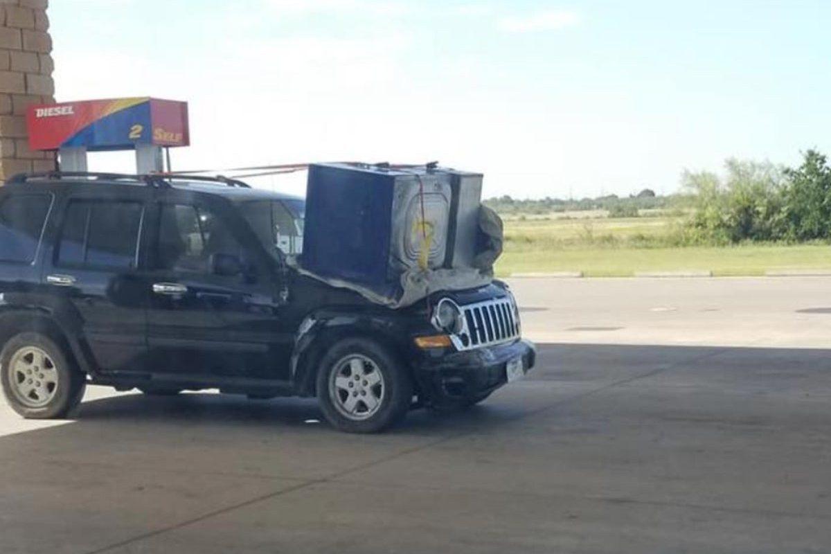 jeep owner hauling washing machine