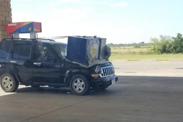 Let This Jeep Owner Be an Example of How NOT to Haul a Washing Machine