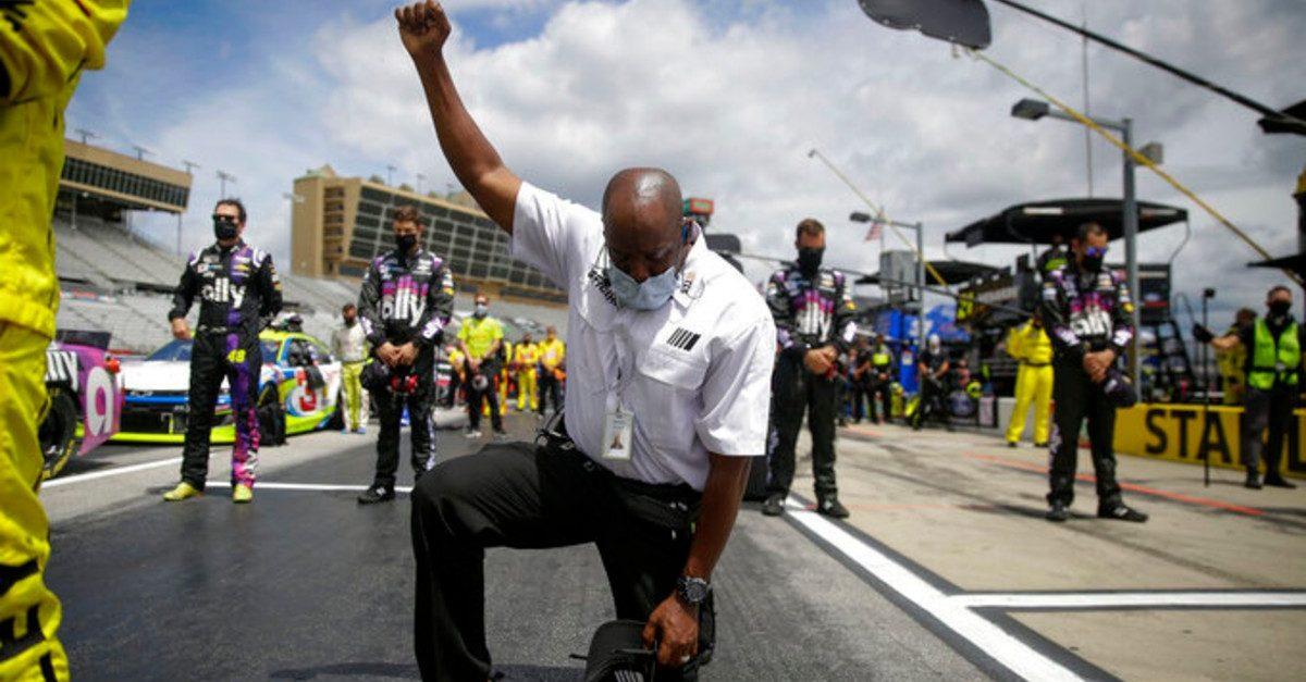 nascar official kneeling