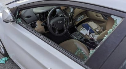 smashed driver's side window