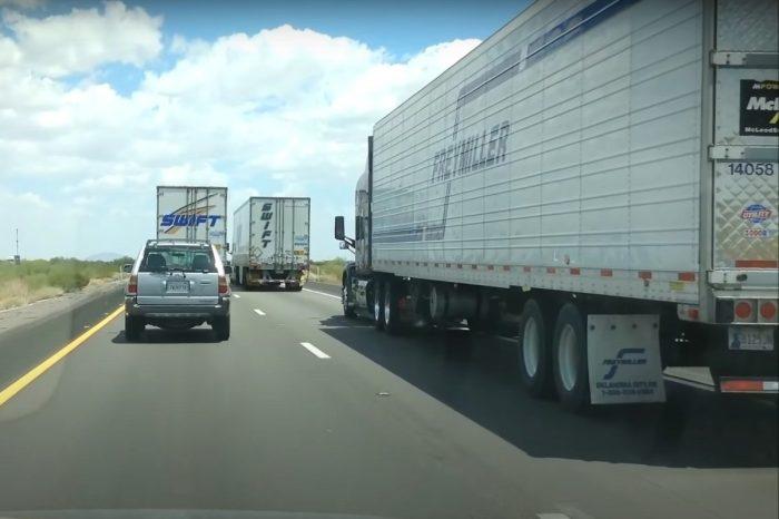 Trucker Speeds Past 2 Semis Blocking the Highway