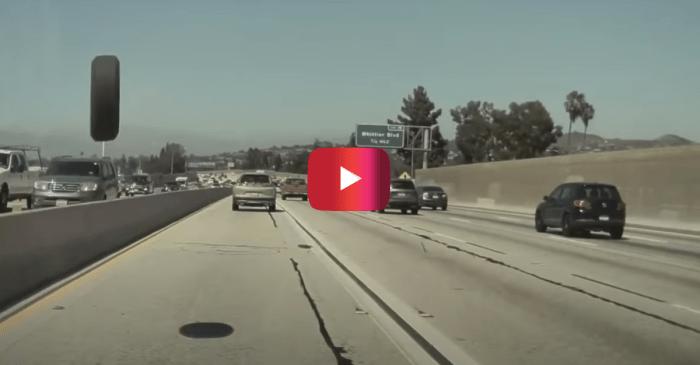Tesla Driver Barely Dodges Flying Tire