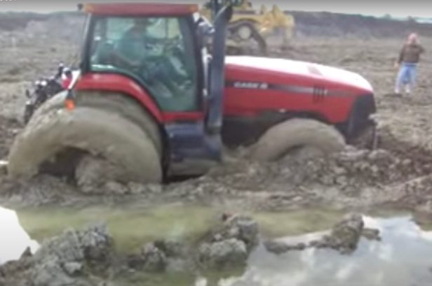 Tractor Stuck in the Mud Powers Its Way Through to Freedom