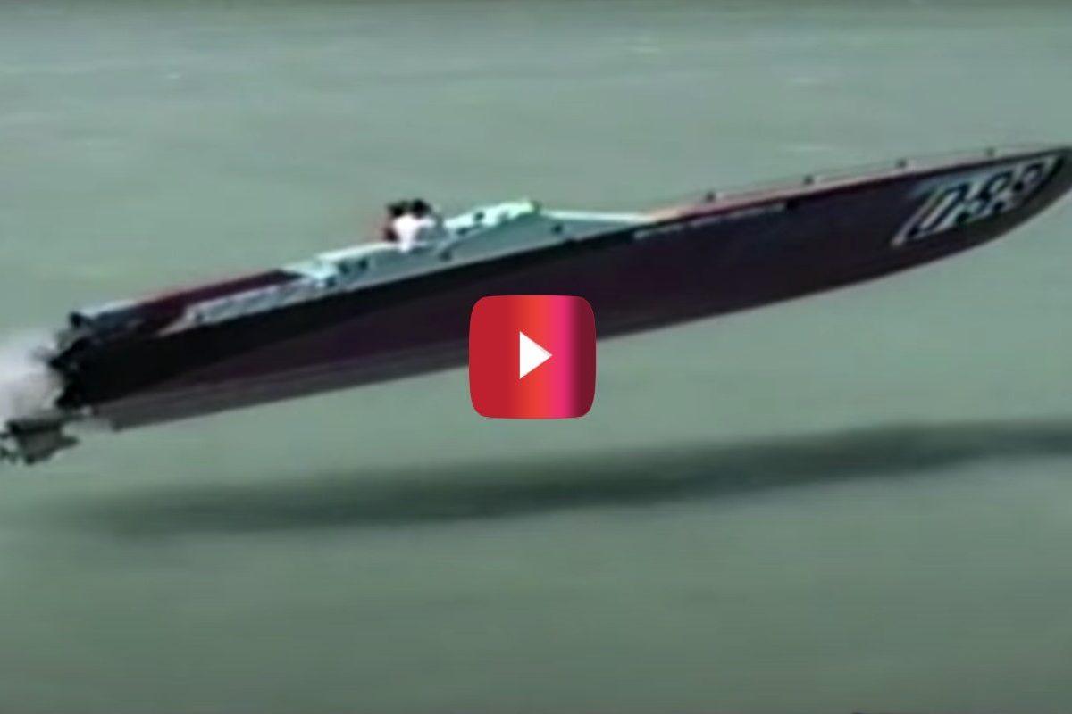 vintage apache powerboat soaring over water