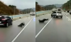 man avoids cars after icy highway crash