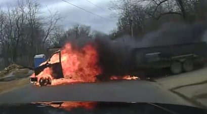 flaming cargo van pulling trailer
