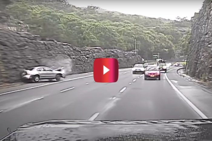 Ford Falcon Spins Out and Crashes on Slick Highway