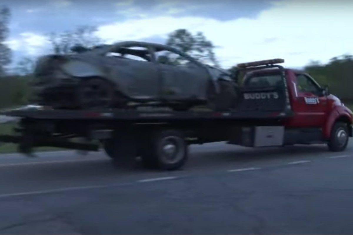 woman's car catches fire from hoarding gas