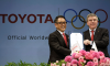 Toyota President and CEO Akio Toyoda and IOC President Thomas Bac