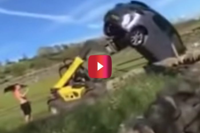 Farmer Uses His Tractor to Flip Car That's Blocking His Gate