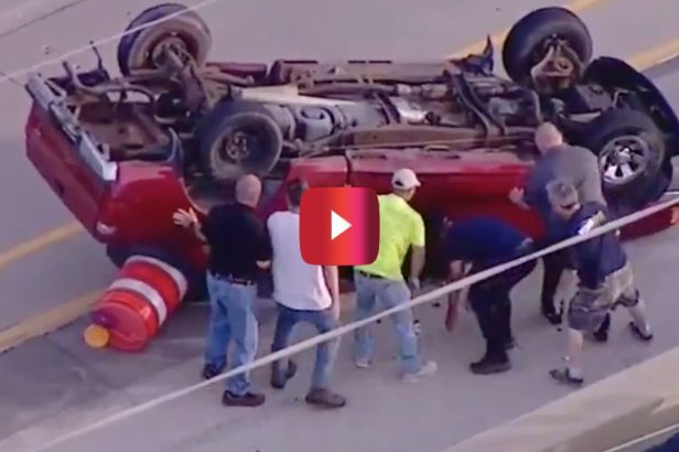 Good Samaritans Help Flip Overturned Truck on Busy Highway to Rescue Driver
